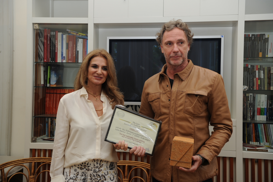Osklen's creative director Oskar Metsavaht with Spanish businesswoman María Eugenia Girón